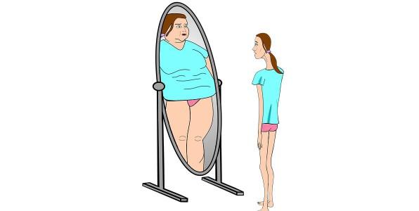 La boulimie se caractérise par une envie incontrôlable de s'alimenter tout en ayant peur de grossir.